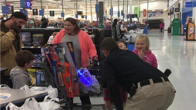 The Fraternal Order of Police, Red River Lodge #36, held its annual Cops and Kids event at the Pineville Walmart Thursday night (Dec. 14, 2017). A little more than $1,700 was raised through donations from local businesses and money raised by the lodge. Each child had about $90 to spend on toys, and it was tough to tell just who was having more fun — the kids or the cops.