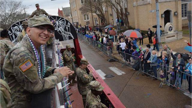 Soldiers from the 46th Engineer Battalion of Fort Polk ride on the Krewe of Boogaloo float Friday, Feb. 9, 2018 in the 2018 Hixson Classic Cars & College Cheerleaders Parade. About 50 soldiers rode on the Boogaloo float and the Krewe of Bayou Le Roux during the parade winding through downtown Alexandria while throwing beads to the crowd.