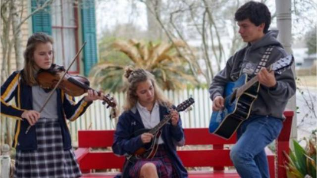 Mary, Georgie Mae and Peter Harris perform at the Brazos Huval School of Music.