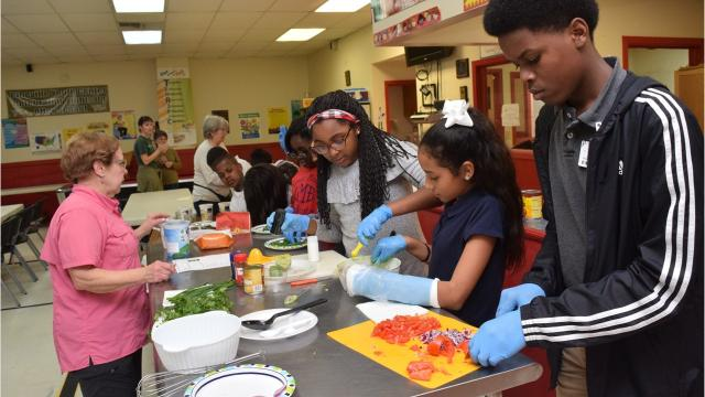 The Garden and Nutrition Club at the Pineville Youth Center, which is part of the Good Food Project, prepared their favorite dishes, a seven-layer dip and a yogurt, fresh fruit and granola cup, for other members of the center for Valentines Day.