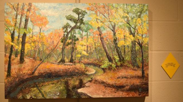 River Oaks Square Art Center director Aubrey Bolen and the U.S. Forestry Service team up to welcome public to view paintings of one of Central Louisiana's most beautiful trails in new exhibit.