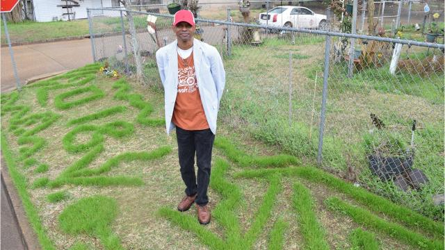 For the past 20 years, Arthur Brown has been using a lawn trimmer to cut patterns and designs in his yard on University and 5th Streets in Alexandria.