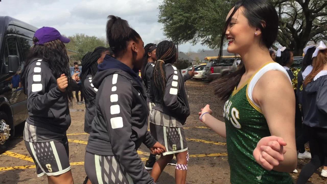 Before heading to Alexandria, the Captain Shreve Lady Gators dance with the band