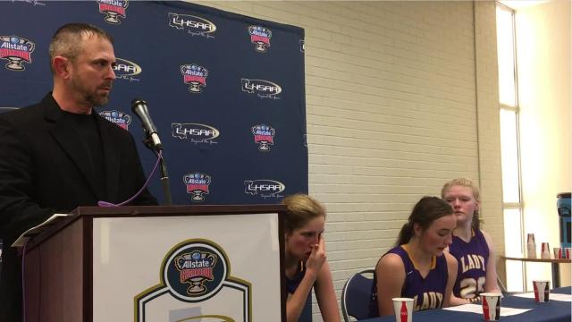 Anacoco coach Tim Parker and players Korie Kreps, Ashlynn Chaney and Annabelle Sellers talk to the media after Saturday's 40-39 loss to Holden.