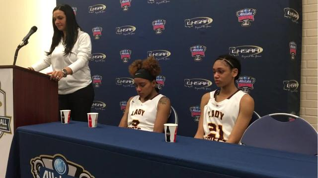 Natchitoches Central coach Nikki Jones and guards Jolie Williams and Teanna Payton talk after Saturday's loss to East Ascension in the Class 5A finals.
