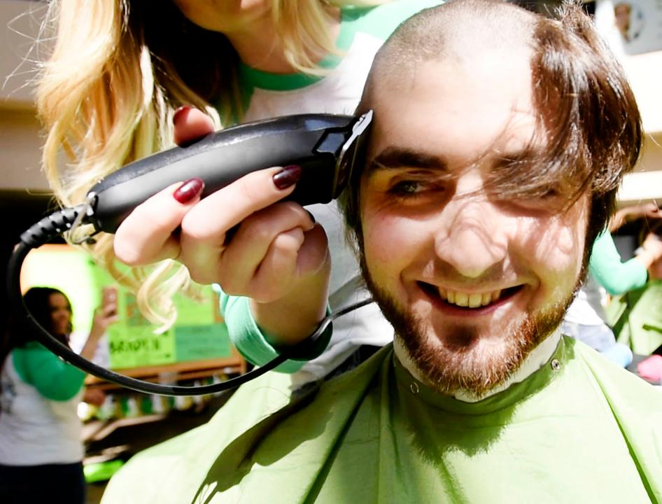 Taylor Smith get his head shaved during the annual St. Baldrick's Foundation Geaux Bald event Friday at LSU Health Shreveport raises funds for childhood cancer research.
