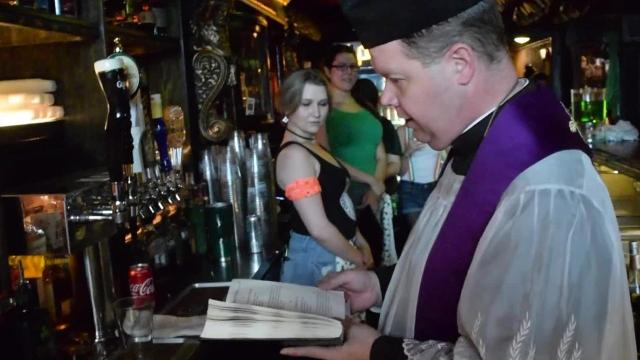 Father Chad Partain, pastor of St. Frances Cabrini Church, conducts the annual Blessing of the Beer at Finnegan's Wake in downtown Alexandria. This was the 11th year for the blessing which is an annual St. Patrick's Day tradition at the pub.