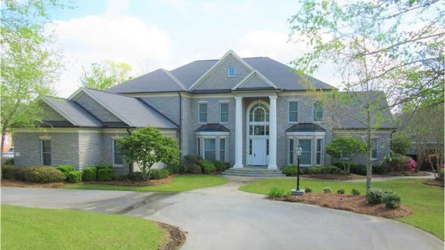 This extravagant home in the Calvert Crossing golf communityfeatures custom stone outside walls from top to bottom, a large circle driveway out front anda 3-car garage with space for a golf cart.