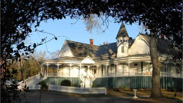 Judge this book by its cover and begin life's next chapter in this charming Queen Anne Revival home overflowing with 116 years ofhistory.