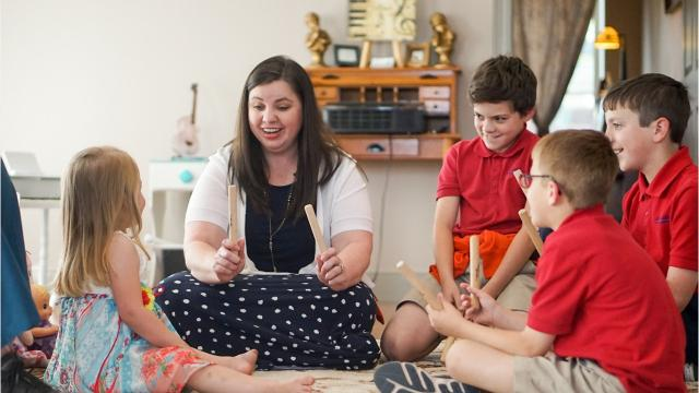 Suzanne Anderson works with students at her First Octave Piano studio in Youngsville, La.