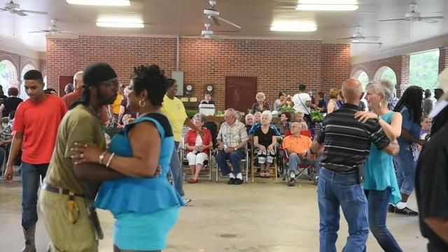 Couples dance to Geno Delafose and French Rockin' Boogie at Music & Market in Opelousas.
