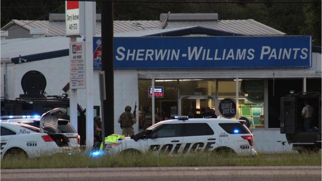When U.S. marshals tried to arrest a man on a warrant Monday in Alexandria, he ran into a nearby business. The man ran into Sherwin-Williams Paints store on MacArthur Drive, beginning a standoff that lasted almost five hours.