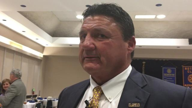 Ed Orgeron speaks to media after being the guest speaker at Tuesday's Alexandria Rotary Club meeting.