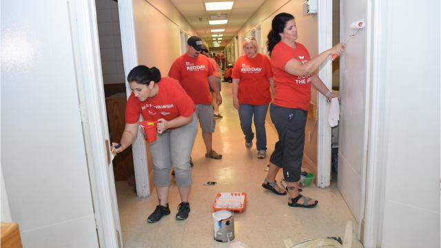Keller-Williams Realty gives back to community by sprucing up Hope House, a transitional housing facility for homeless women and children, and feeding the residents.