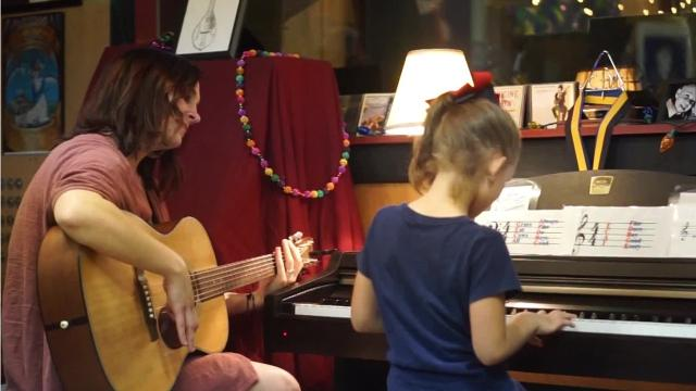 Grammy-nominated musician Maegan Berard Rankin plays music with her daughter Claudia, 6, at the family's studio in Cecilia, La.