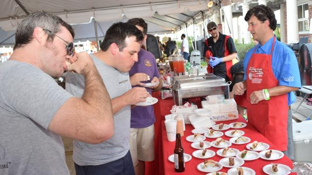 The 18th annual Men Who Cook & Men Who Mix fundraiser for River Oaks Arts Center in downtown Alexandria was held Saturday, May 19, 2018. Twenty-eight teams with 89 chefs participated in the event with attendees providing tips to the teams with the entrees they liked. Votes were tabulated by the amount each jar received. A silent auction was also held. The Cenla Brass Band and MC Matt Ranson provided entertainment.