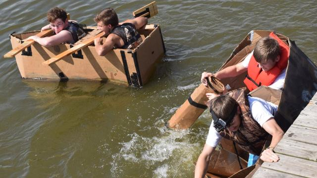 Principles of engineering students from Tioga High School built canoes make out of cardboard and duct tape. Four teams consisting of four students each held a race at Lake Buhlow in Pineville on Tuesday to test their canoes' seaworthiness.