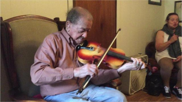 Willie Durriseau, 100, plays Creole fiddle at his home in Opelousas, La. Durriseau, a World War II veteran, plays a bluesy style considered long forgotten.