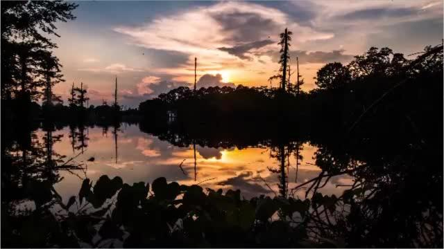 Time lapse sunsets of Bayou DeSiard and of downtown Monroe