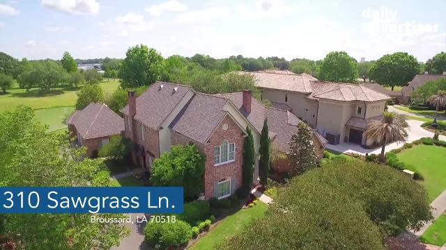 This awesome estate in Broussard is under $900k