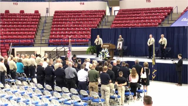 An American flag was folded for K-9 Boco and presented to his handler at a Thursday memorial for the Lincoln Parish Sheriff's Office deputy.