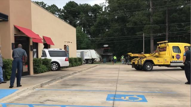A wrecker service removes an SUV from Dairy Queen on U.S. 165 North.