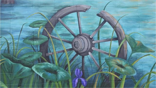 Local artist Leah Morace created the mural on the Place du Marche Shopping Center's wall in Marksville. It was sponsored by D'Argent Companies and coordinated by River Oaks Square Arts Center and the Avoyelles Commission of Tourism.