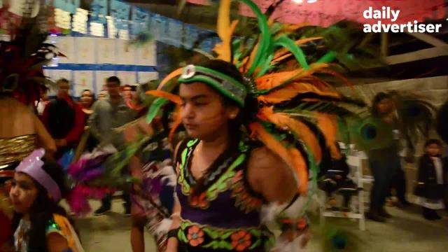 The Aztecs perform during a fiesta in honor of the Day of the Virgin of Guadalupe after a Spanish Mass held at St. Jules Catholic Church in Lafayette.