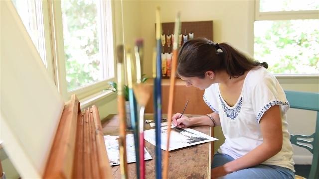 WATCH: Local artist finds time to paint while her children nap