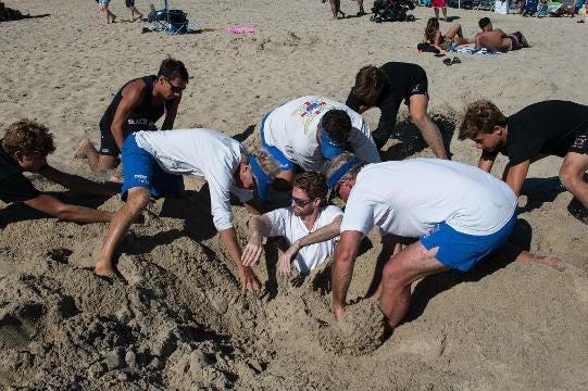 WATCH: Delmarvanow reporter is buried and extracted from the sand