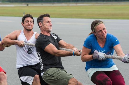 Teams pull a Dash-8 aircraft to raise money for the local United Way chapter.