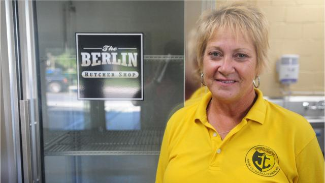 A meat distributor is pursuing charges against a former Berlin councilwoman, alleging she paid for thousands of dollars worth of meat with bad checks.