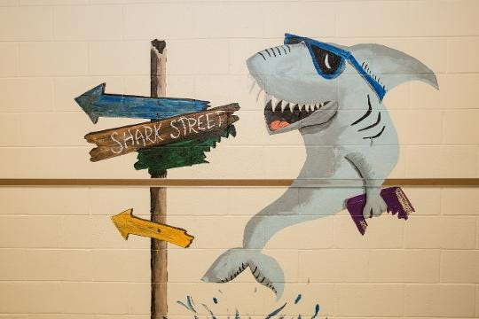 Art teacher Robin Daniels has painted several murals in the halls of Woodson Elementary and throughout Crisfield.