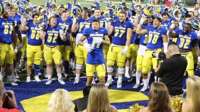 As the University of Delaware football team gathers in the endzone after its game against the College of William & Mary to sing its alma mater and school fight song, freshman Tylan McElhenie breaks out for his own rendition of the Chicken Dance.