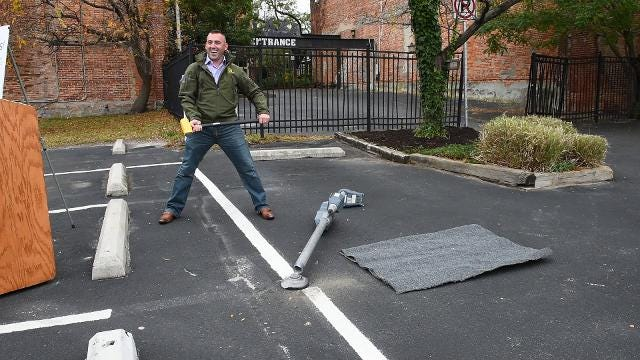 With the installation of new parking kiosks, Jake Day used a sledgehammer to remove an old one.