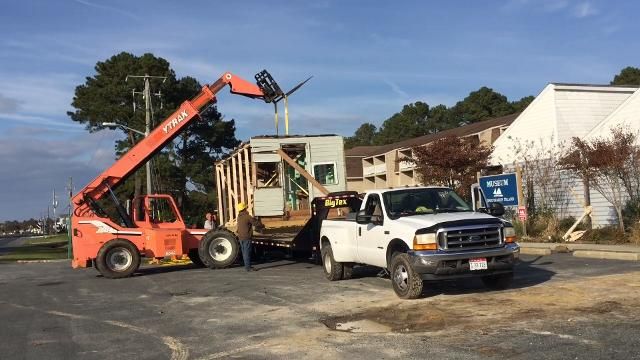 Miles Hancock's workshop is being moved about a mile from his former home on Chincoteague, Virginia to the grounds of the Museum of Chincoteague Island. The first of four sections of the building was transported on Tuesday, Nov. 14, 2017.