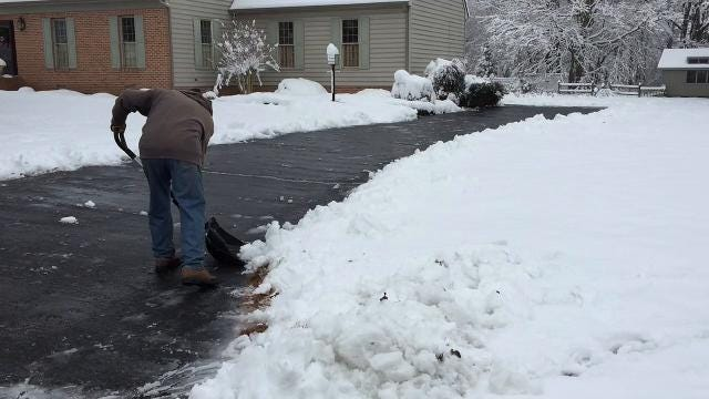 John Buchanan, 69, of Salisbury shovels his driveway in the Cross Creek neighborhood Saturday morning. He said it's way too early for this. Originally from Pittsburgh, he said he has lived here 30 some years and was not expecting snow this early.