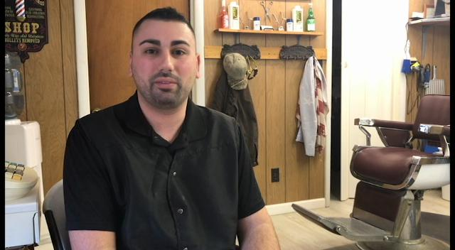 WATCH:  Millville barber buzzing Eagles logo into hair