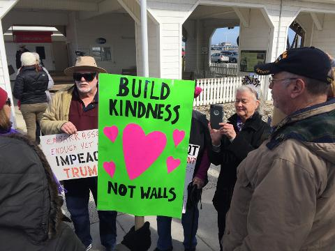 About 75 protesters marched on the Boardwalk to call attention to what they see as Trump's norm-shattering behavior.