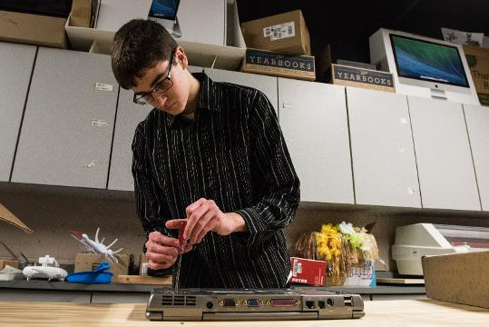 A Sussex Central High School student repairs computers and cell phones for hurricane survivors in Puerto Rico.