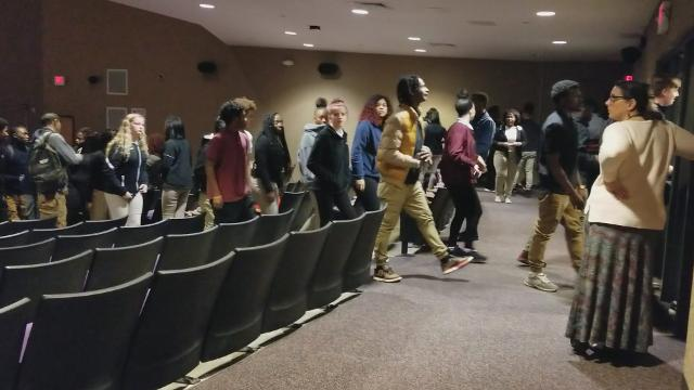 "Students leave the Washington High School and Academy following a 17-minute ""moment of silence"" in recognition of the 17 high school students who died in a school shooting in Parkland, Florida. The event was optional for students in grades 8-12."