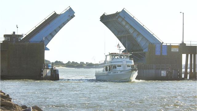 An Ocean Pines woman has been charged with intoxicated public disturbance and disorderly conduct after police say she jumped from the Route 50 drawbridge into Ocean City.