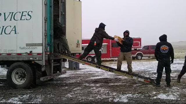 Fire personnel unloaded supplies in the snow at incident command headquarters for the Alice Creek fire in Montana.