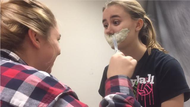 Lydia Fangmeier (artist) and Desteni Yatsko (model), GFHS sophomores, complete a scary makeup design.