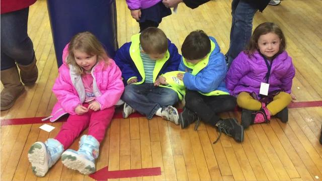 Great Falls firefighters donate 250 new winter coats to children in need.