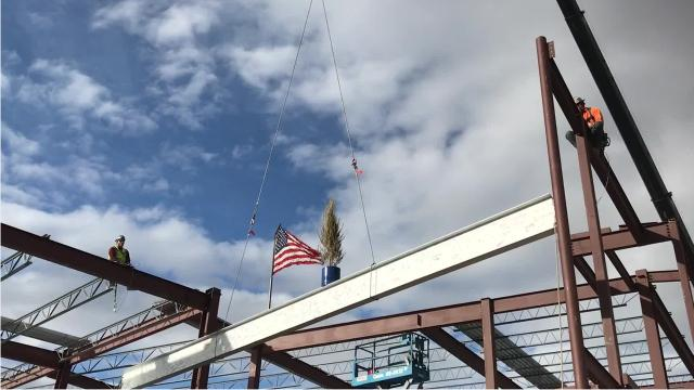 "Great Falls Public Schools hosts a ""topping out"" ceremony to celebrate the placement of the final structural beam at Giant Springs Elementary."