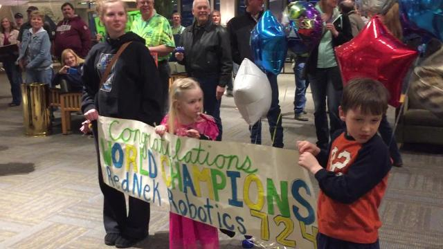 Hero's welcome meets robotics team after world championship win at the FIRST World Championship Competitions in Houston, Texas.