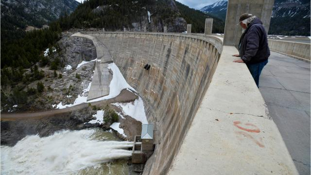 Gibson Dam on the edge of the wilderness has been storing water in the Sun River to use for irrigation for almost a century.