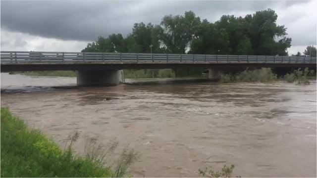 The Sun River is rapidly rising and area residents prepare for flooding.