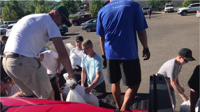 Community volunteers turned out to fill sandbags at Home Depot in Great Falls on Wednesday after a flood warning was issued for the Missouri River in Great Falls.  The river is expected to crest at 17 feet, noon on Thursday.